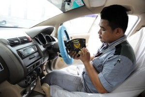Honda Malaysia technician replacing a Takata driver front airbag inflator