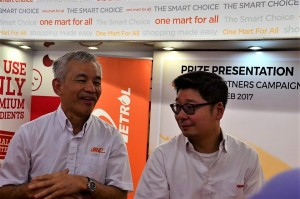 L-R: Tan Kim Thiam with Nicholas Tan, Director, Tan Chong Group.
