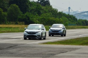 New Honda CR-V following current CR-V in Adaptive Cruise Control test.
