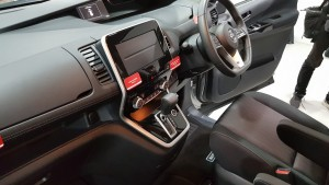 Walk-through cabin, with gear lever on dashboard.