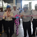 Mr Takahashi Masanori (front left) and YBhg Dato' Zainal Abidin Ahmad, respectivley President and Vice-President of Perodua Auto Corporation Sdn Bhd, cutting the ribbon to officiate the opening of the Myvi Service Parts Line at IQM Tanjung Malim. Looking on is IQM Executive Director En Aidil Azlan Mohd Fitri (back, middle) and IQM Group Business and Marketing General Manager En Azrai Ramli (back, right).