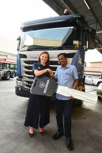 Scania Southeast Asia Managing Director, Marie Sjödin Enström with En. Tajnoor of LLZ Haulage.