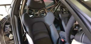 Race bucket seats and roll cage are included in the package
