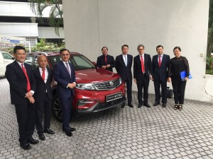 The management of AmBank, CGC and Proton posing with the X70 SUV.