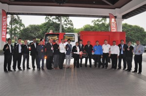 Tenaga Nasional Bhd and Isuzu Malaysia management pose with one of the ELF trucks.