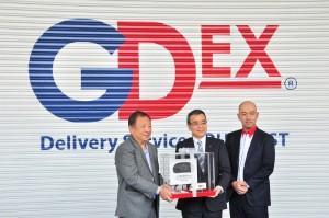 L-R: Teong Teck Lean; Yasuhiko Ichihashi, Chairman, Hino Motors Limited; Atsushi Uchiyama
