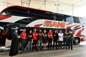 Winners of Sani Express' social media contest pose with Sani Express and Scania management.